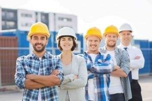 5 building contractors standing together