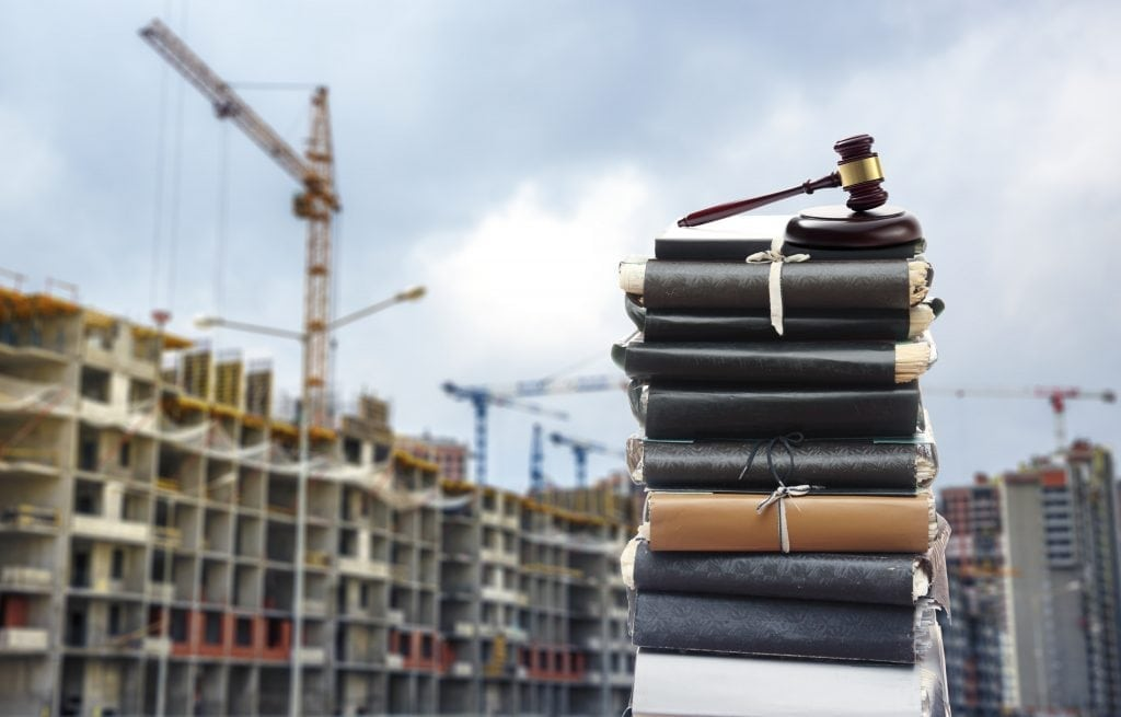 planning permission documents in uk with building and construction happening in background