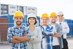 5 home builders outside a construction site
