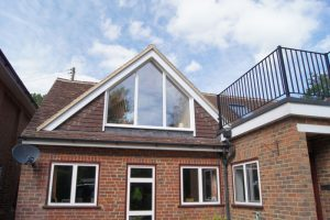 HIP TO GABLE conversion with full glass on front side of house