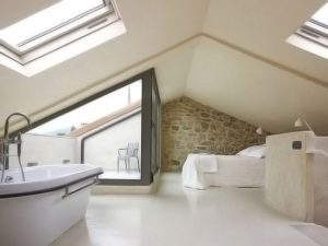 Hipped roof conversion displayed and space is being used as bathroom