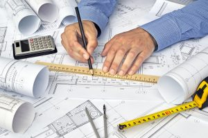 architect writting a time plan for the project