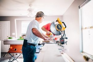 A Loft builder holding his tools