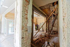 A home builder on a Ladder