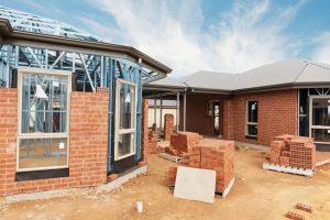 A home builder working on bricks