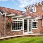 single storey brick extension on a greater London Home with white windows