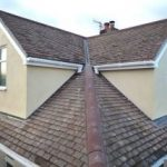 double square hipped loft conversion twin with tiled roof and white windows