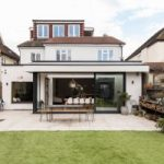 wrap around house extension displayed on a white brick house somewhere in greater london