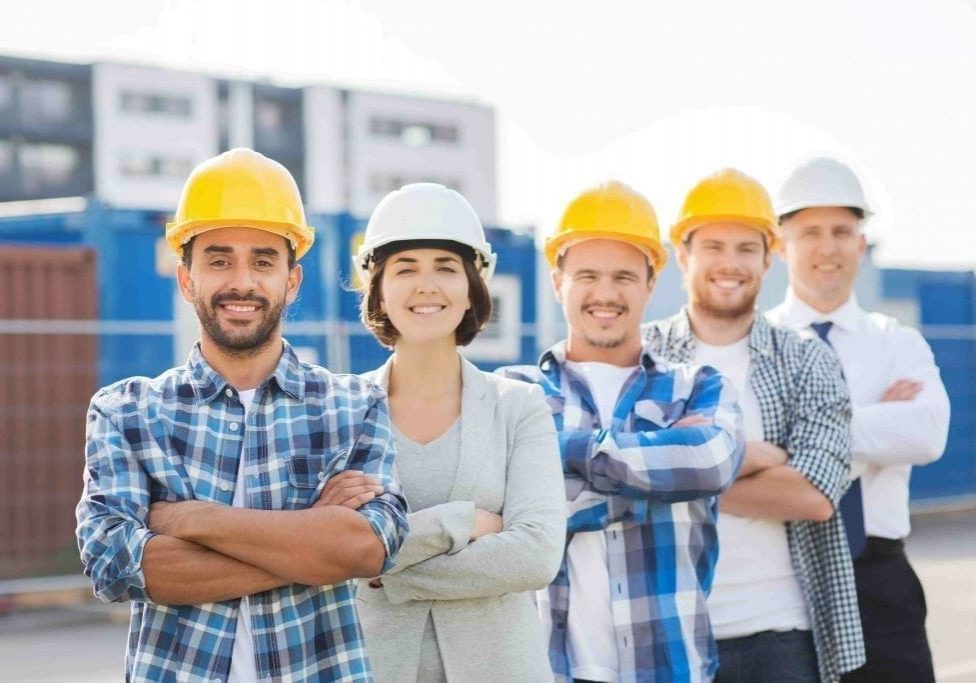 5 building contractors standing together