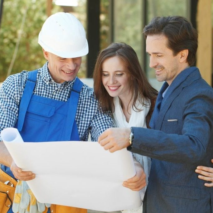 Man and woman searching for an extension builder